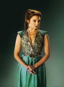 This image is a lot greener than the official promo (http://bit.ly/1xmAybl). I liked it a lot more because the color of her dress stayed faithful to the book depiction of Tyrell color green.