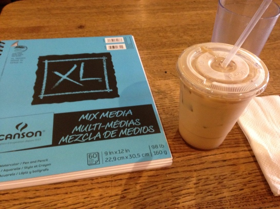 Took this image of my sketchbook and iced vanilla latte at the cafe before she arrived.